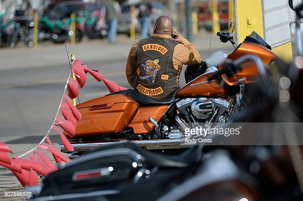 A motorcycle club member talks on his cell phone in a parking lot across from the National Western Stock Show Complex January 30 2016 Denver Police...