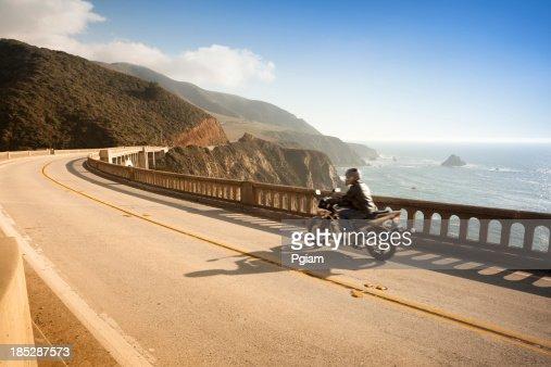 Motorcycle crossing the Bixby Bridge, Big Sur, California, USA