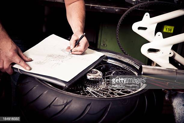 motorcycle designer sketching a new bike