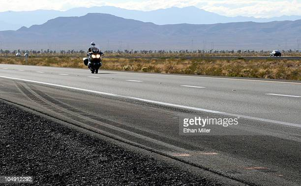 A motorcycle drives by skid marks from a semitractor trailer on northbound Interstate 15 on October 6 2010 near Mesquite Nevada Steve Lee frontman...