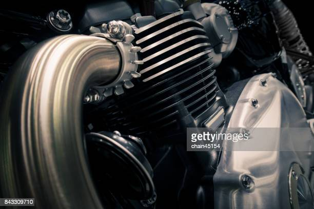 Motorcycle engine close-up detail background.