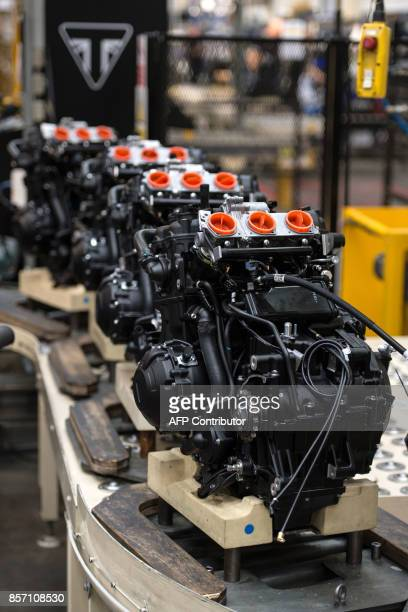 Motorcycle engines are pictured on the assembly line at the Triumph Motorcycles factory in Hinckley central England on October 2 2017 Triumph which...