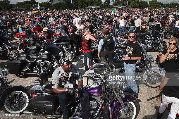 Motorcycle enthusiasts gather in a parking lot at Miller Park beforeriding in a parade through downtown to celebrate HarleyDavidson's 110th...