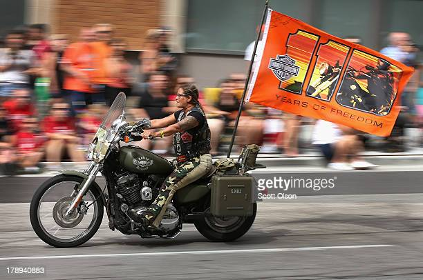 Motorcycle enthusiasts ride their bikes in a parade through downtown to celebrate HarleyDavidson's 110th anniversary on August 31 2013 in Milwaukee...