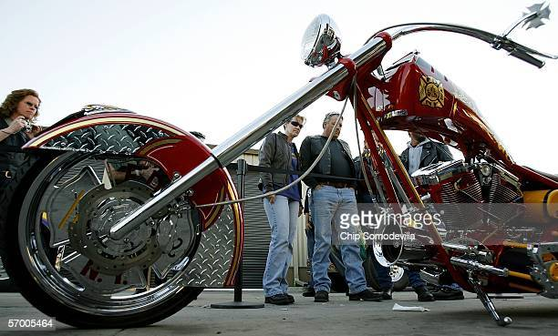 Motorcycle enthusists stop to look at the Orange County Chopper 'Fire Bike' on display during the first weekend of Bike Week March 5 2006 in Ormond...