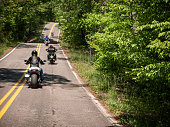 Group ride through country roads.