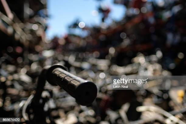 A motorcycle handlebar is seen among the millions of used engine components at 'The Bike Hospital' on October 18 2017 in Johannesburg South Africa...