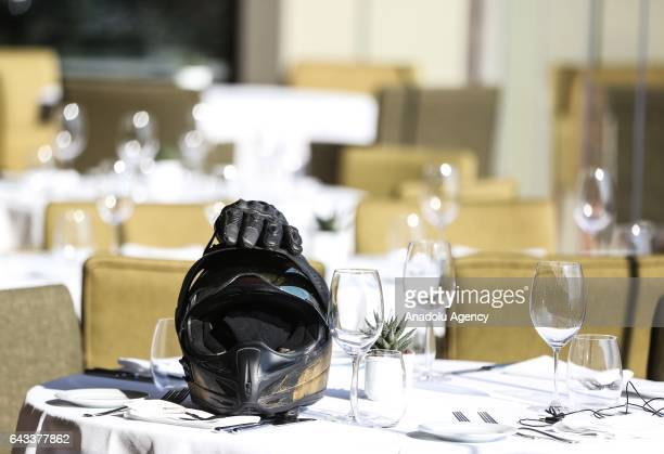 A motorcycle helmet and a glove are seen on a dining table during an introductory meeting of Motobike exhibition organized by Messe Frankfurt...