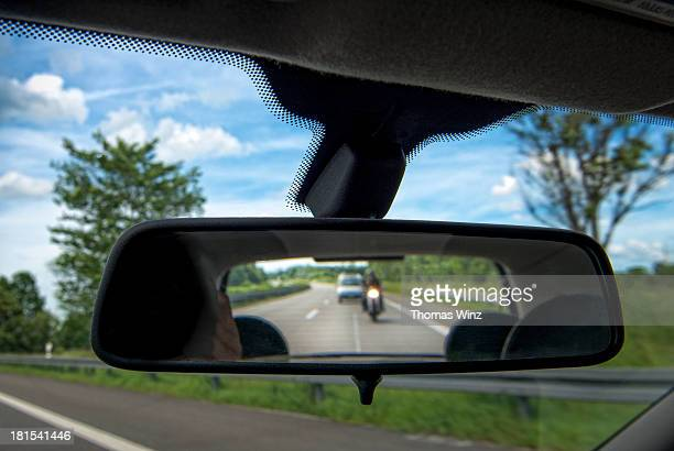 Motorcycle in rear view mirror