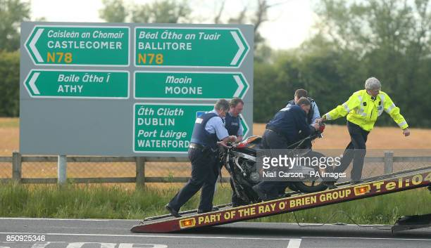 A motorcycle is loaded onto a lorry on the N78 close to Athy Co Kildare after two people died and a third was seriously injured in a road crash