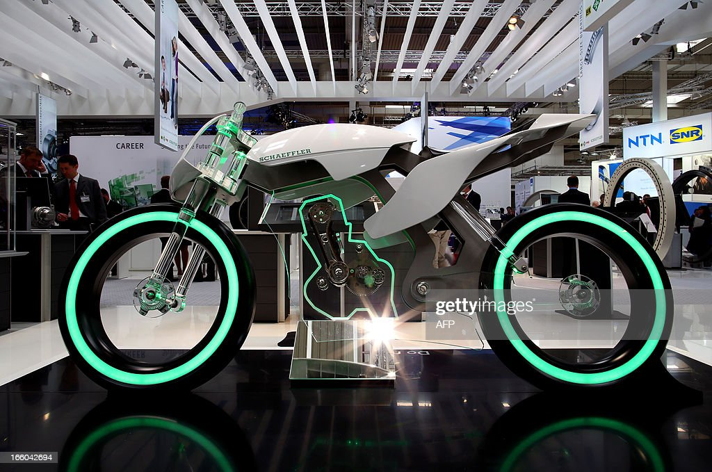 A motorcycle made of glass is on display at the booth of German company Schaeffler technologies at the industrial trade fair in Hanover, central Germany on April 8, 2013. The fair running from April 8 to 12, 2013 will present a cross section of key industrial technologies..