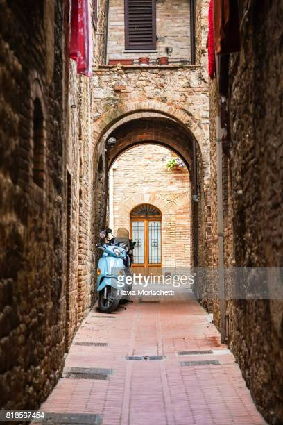 Motorcycle parked in San Gimignano street, Tuscany