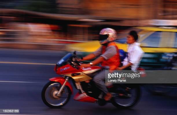 Motorcycle passengers on Th Ratchaprarop, Pratunam.