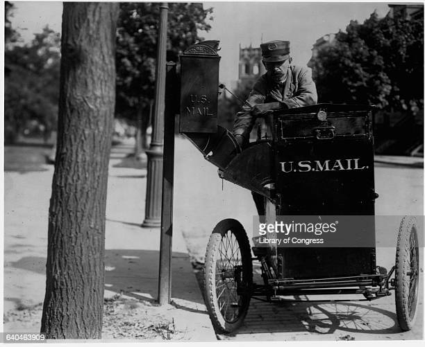 Motorcycle Postman Collecting United States Mail