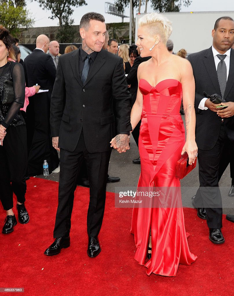 Motorcycle racer <a gi-track='captionPersonalityLinkClicked' href=/galleries/search?phrase=Carey+Hart&family=editorial&specificpeople=696730 ng-click='$event.stopPropagation()'>Carey Hart</a> and singer Pink arrive attend the 56th GRAMMY Awards at Staples Center on January 26, 2014 in Los Angeles, California.