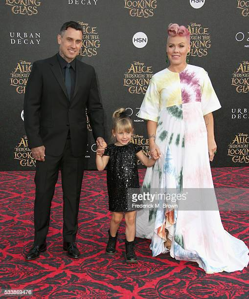 Motorcycle Racer Carey Hart Willow Sage Hart and singersongwriter Pnk attend the premiere of Disney's 'Alice Through The Looking Glass at the El...