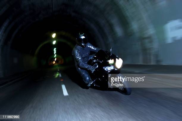 Motorcycle Racing Through Tunnel at Night