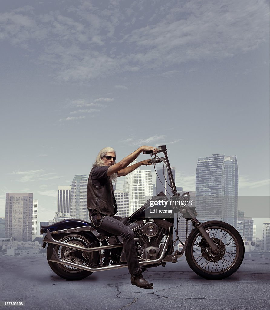 Motorcycle Rider with City Background : Stock Photo