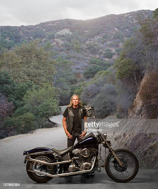 Motorcycle Rider with Country Road Background