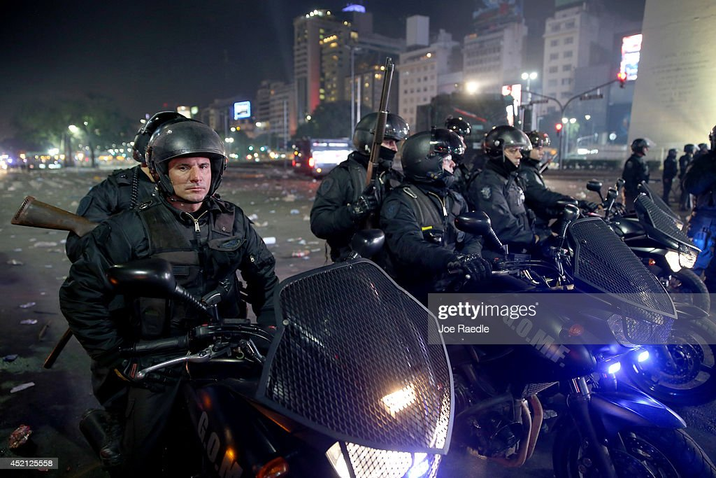 Motorcycle riding police officers work on controling Argentine soccer fans that became violent near the Obelisco de Buenos Aires after their team lost to Germany 1-0 during the World Cup final on July 13, 2014 in Buenos Aires, Argentina. Germany won their 4th World Cup in the final match played in Rio de Janeiro.