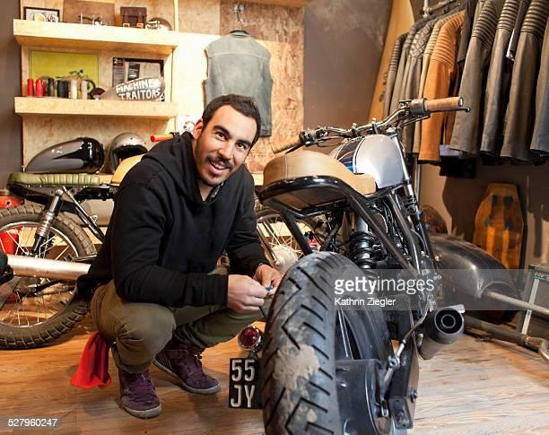 motorcycle shop owner in his showroom