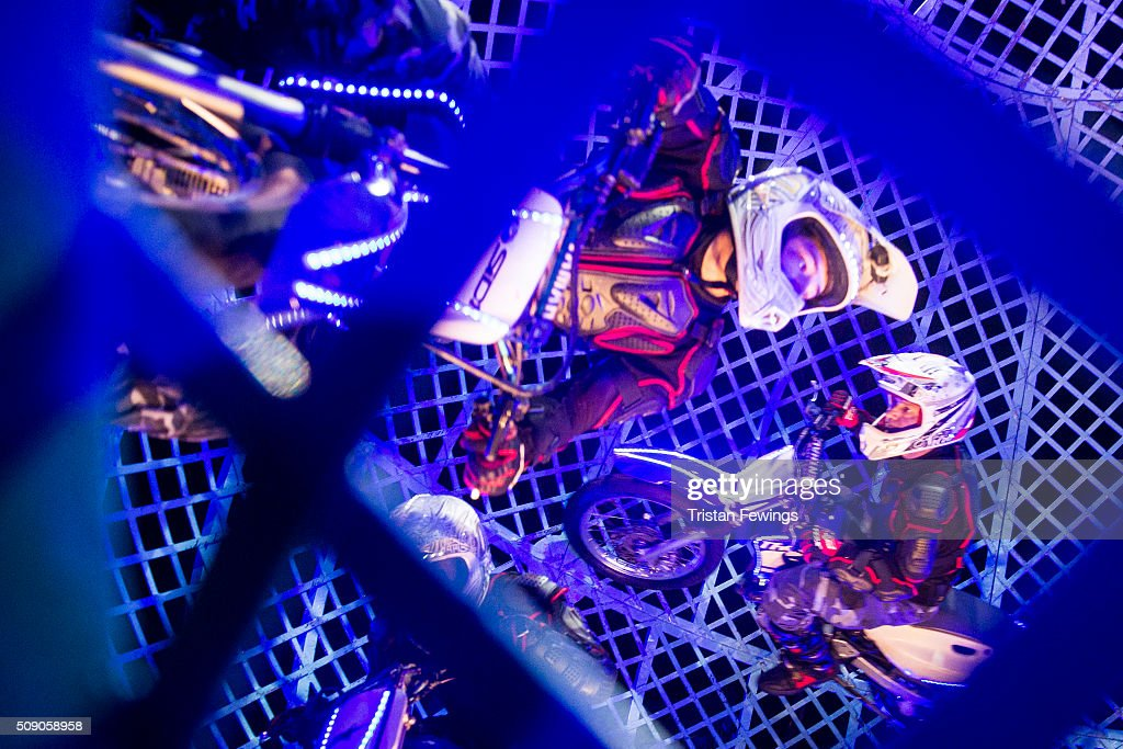 Motorcycle stunt riders perform in the Globe of Terror at the Cirque Berserk rehearals ahead of the circus opening night at The Peacock Theatre on February 8, 2016 in London, England.