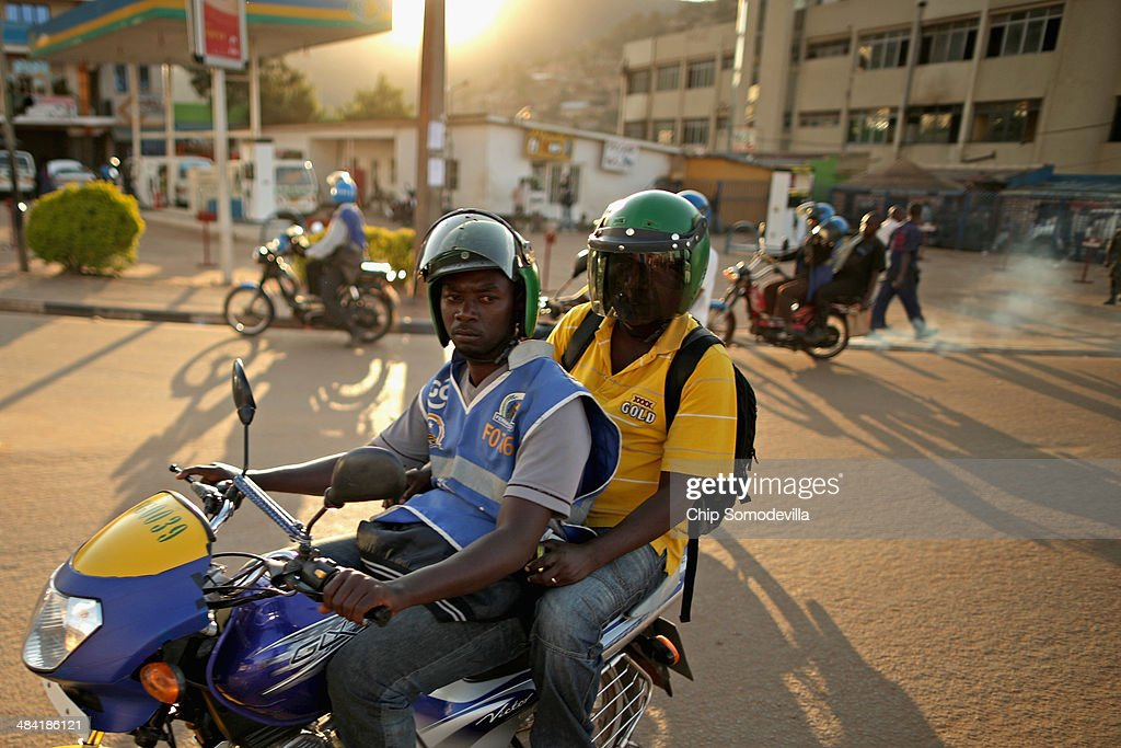 Motorcycle taxis, called 'boda-boda' in East Africa, carry passengers quickly and inexpensively in the Nyabugogo neighborhood April 9, 2014 in Kigali, Rwanda. Boda-boda dominate the roads in Kigali, a city build on a serise of hills and valleys. Many drivers pay dues and belong to co-operatives which represent their interests with local and central government agencies. As motorcycles cost more than 1.3 million Rwandan Francs (or about $1900 US), many riders pay a weekly fee of about $40 US to the bike owners and keep whatever they make beyond that amount. Working 13-hour shifts, boda-boda drivers can carry about 25 passengers on a good day of business.