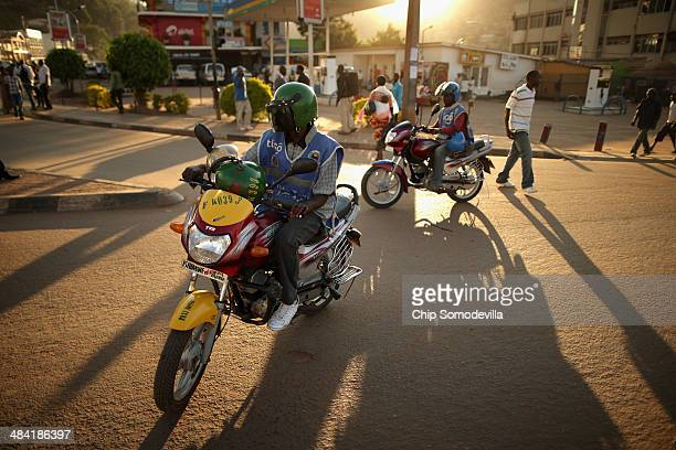 Motorcycle taxis called 'bodaboda' in East Africa carry passengers quickly and inexpensively in the Nyabugogo neighborhood April 9 2014 in Kigali...