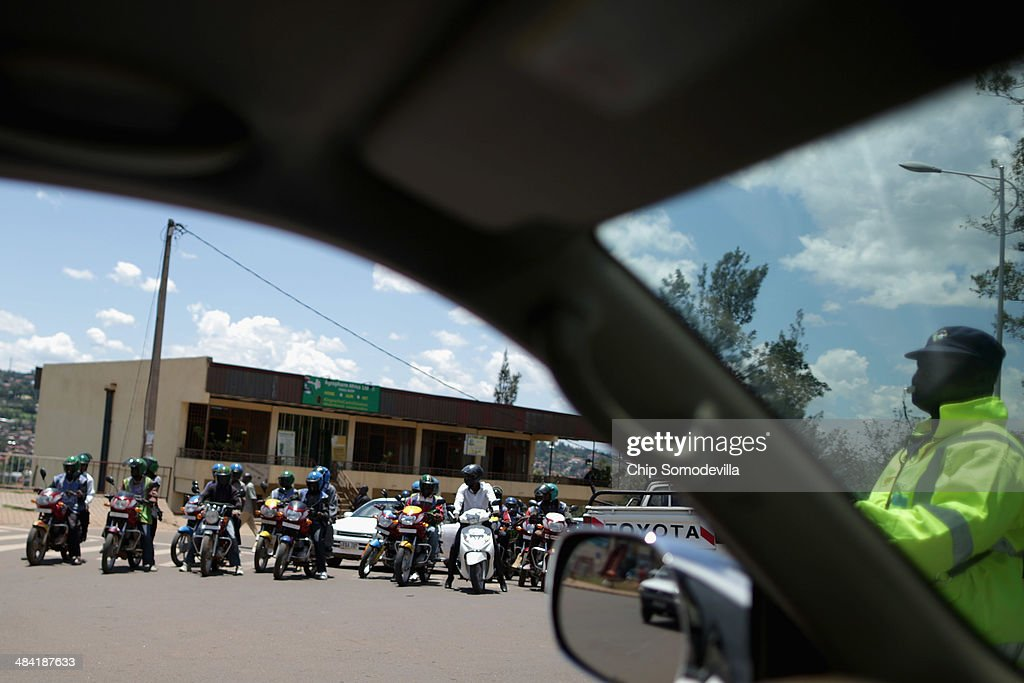 Motorcycle taxis, called 'boda-boda' in East Africa, crowd the front of an intersection in the Nyabugogo neighborhood April 9, 2014 in Kigali, Rwanda. Boda-boda dominate the roads in Kigali, a city build on a serise of hills and valleys. Many drivers pay dues and belong to co-operatives which represent their interests with local and central government agencies. As motorcycles cost more than 1.3 million Rwandan Francs (or about $1900 US), many riders pay a weekly fee of about $40 US to the bike owners and keep whatever they make beyond that amount. Working 13-hour shifts, boda-boda drivers can carry about 25 passengers on a good day of business.