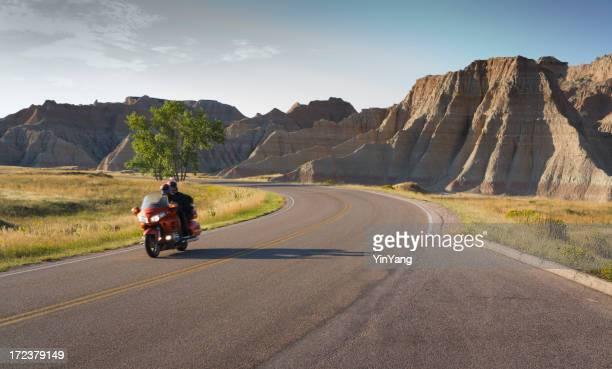 Motorcycle Touring, Biker Riding in Badlands South Dakota Landscape