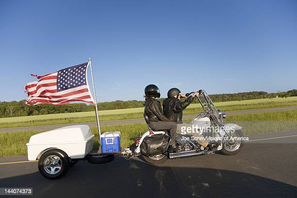Motorcycle with trailer and US Flag blowing in wind driving down Route 13 of the Eastern Shore of Maryland