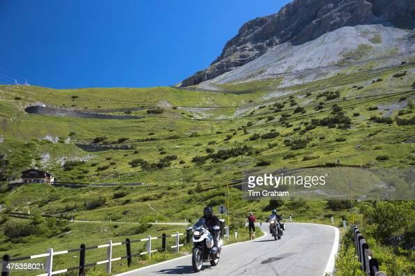 Motorcycles and walker on Stelvio Pass Passo dello Stelvio Stilfser Joch on route Trafoi to Bormio the Alps Northern Italy