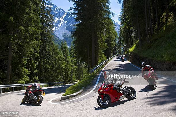Motorcycles on The Stelvio Pass Passo dello Stelvio Stilfser Joch route from Bormio to Trafio in The Alps Italy