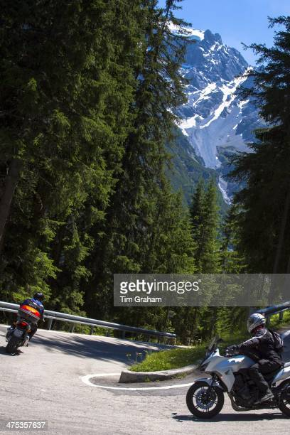 Motorcycles on The Stelvio Pass Passo dello Stelvio Stilfser Joch route to Trafio in The Alps Italy