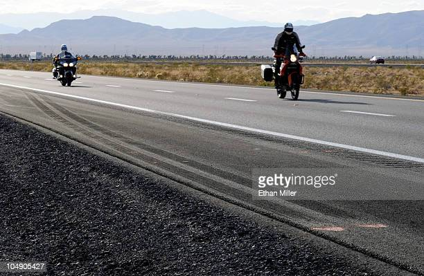 Motorcycles pass by skid marks from a truck on northbound Interstate 15 on October 6 2010 near Mesquite Nevada Steve Lee frontman for the Swiss rock...