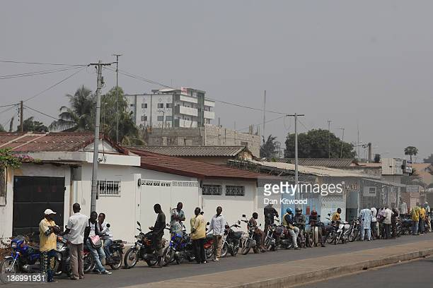 Motorcycles queue for a petrol station on January 12 2012 in Cotonou Benin A removal of subsidy on fuel by the neighbouring Nigerian Government has...