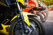 motorcycles standing in the row on asphalt road closeup