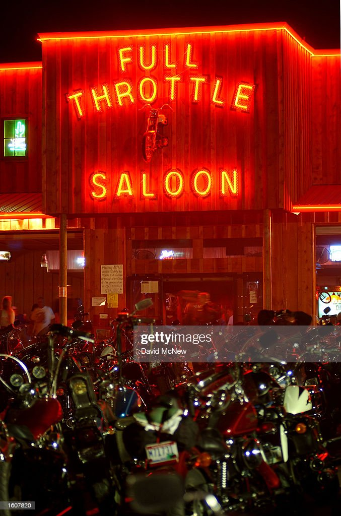 Motorcycles surround the Full Throttle Saloon, which claims to be the world''s biggest biker bar, during the 61st annual Sturgis Motorcycle Rally, August 11, 2001, in Sturgis, SD. The Full Throttle, in its second year, is only open during the rally.