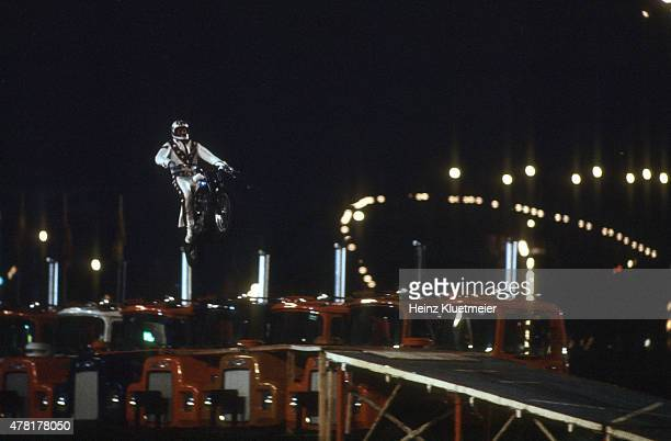 Daredevil Evel Knievel in action during jump over 13 Mac trucks during Canadian National Exhibition at Exhibition Place Toronto Canada 8/20/1974...