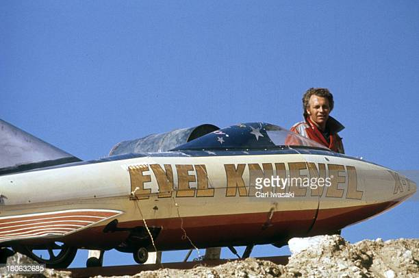 Portrait of daredevil Evel Knievel posing with rocket Skycycle X2 one year before jump at Snake River Canyon Twin Falls ID CREDIT Carl Iwasaki