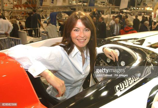 Motorcycling presenter Suzi Perry takes a close look at the newly unveiled British American racing 225HP powerboat on the opening day of the 49th...