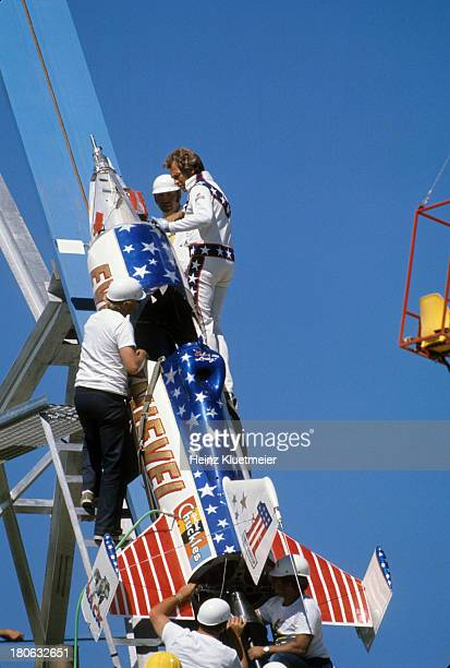 View of daredevil Evel Knievel entering rocket Skycycle X2 with crew while preparing for jump over Snake River Canyon Twin Falls ID CREDIT Heinz...