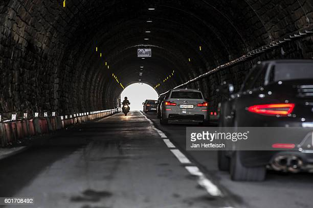 A motorcyclist and cars drive through the tunnel of the the Hochtor on September 08 near Zell am See Austria The Grossglockner high alpine road is...
