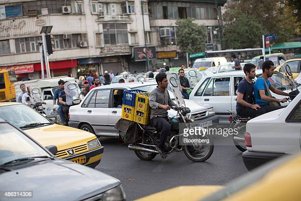 A motorcyclist carries crates of soft drinks through heavy traffic in Tehran Iran on Monday Aug 31 2015 Irans Supreme Leader Ayatollah Ali Khamenei...