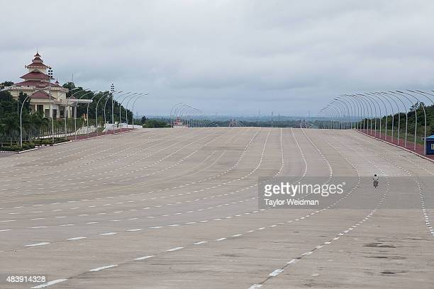 A motorcyclist drives down a 20lane highway on August 13 2015 in Naypyitaw Burma The capital of Myanmar was moved from Yangon to Naypyitaw nearly 10...