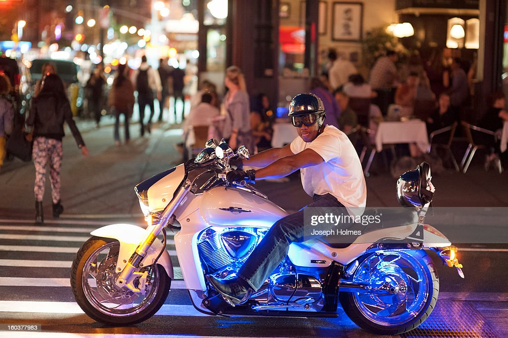 CONTENT] A motorcyclist in Manhattan's west 20s shows off a blue neon effect on his bike, achieved by the addition of LED light kits.