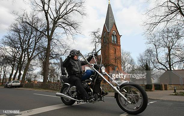 A motorcyclist leaves an Ecumenical worship ceremony for the beginning of the 2012 motorcycling season in the Grossziethen village church on April 1...