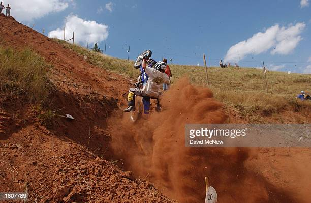 A motorcyclist loses control during his run up the hill climb competition at the Jackpine Gypsy Club Grounds during the 61st annual Sturgis...
