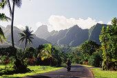 Motorcyclist on Polynesian road