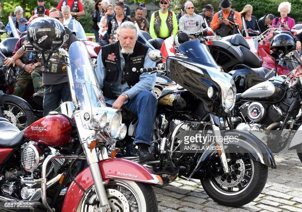 A motorcyclist prays during the 'Blessing of the Bikes' at the Washington National Cathedral May 26 2017 in Washington DC / AFP PHOTO / ANGELA WEISS